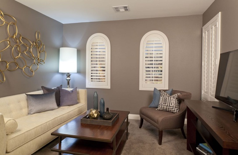 New York City family room with rounded plantation shutters.
