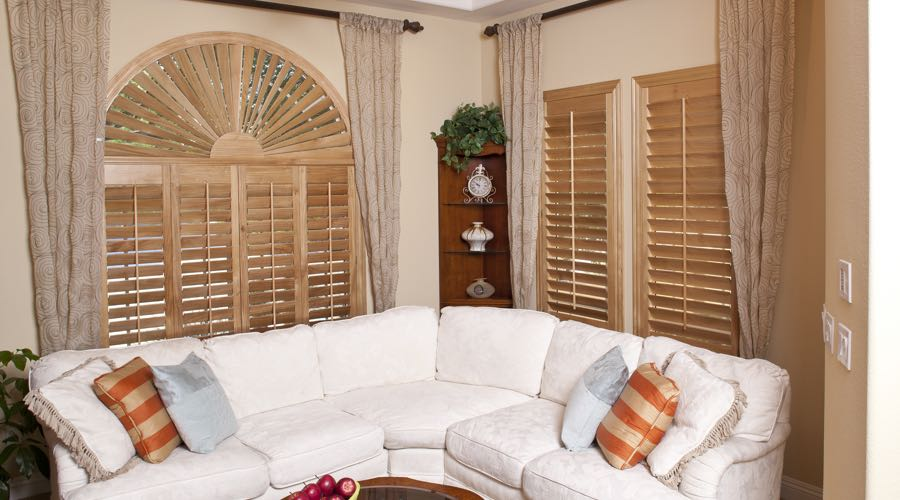 Arched Ovation Wood Shutters In New York City Living Room