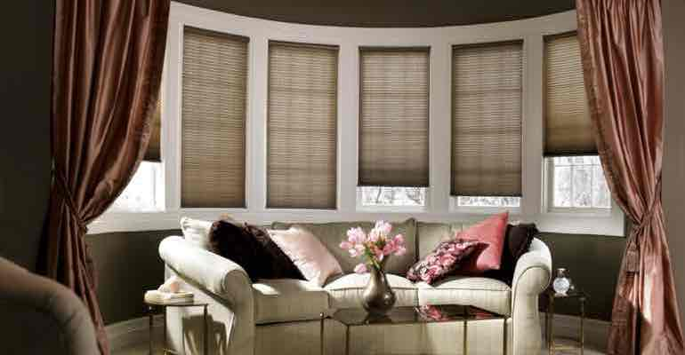 Brown honeycomb shades in parlour bow window.