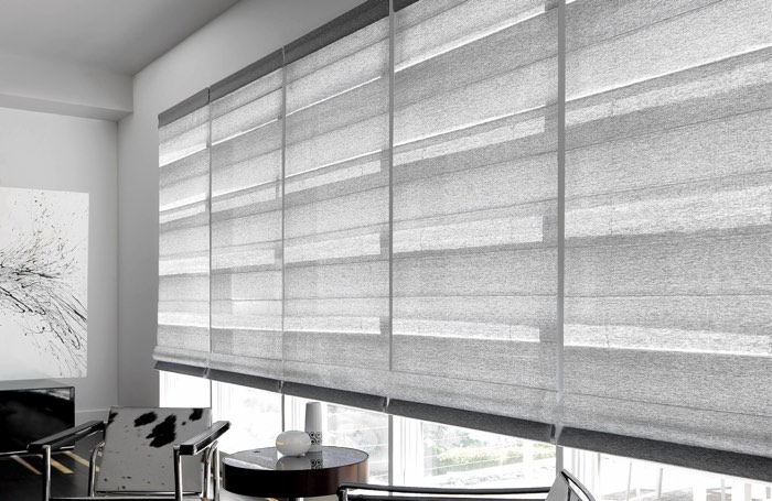 Gray shades covering wide business window