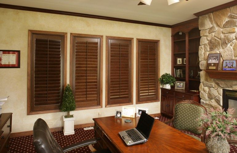 Wooden plantation shutters in a New York City home office