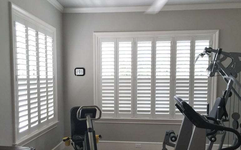 New York City home gym with shuttered windows.