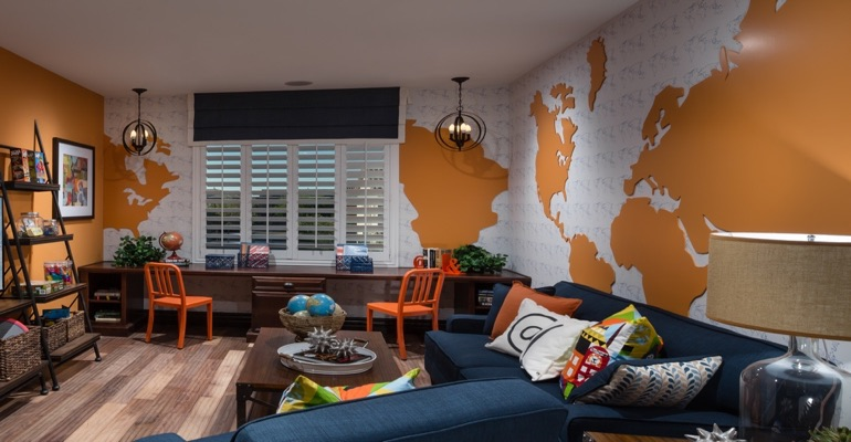 Family room with wall map and plantation shutters