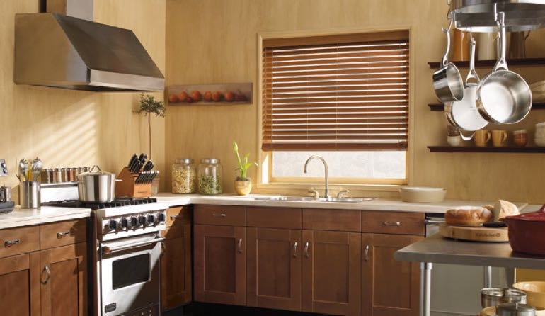 New York City kitchen faux wood blinds.