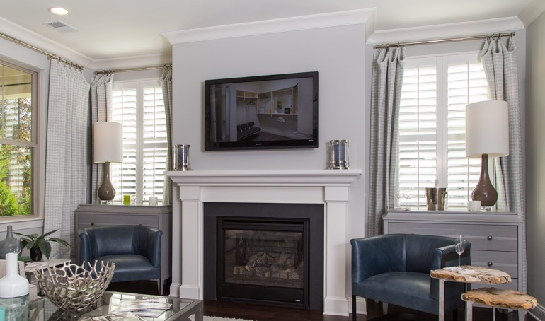 New York City fireplace with white shutters.