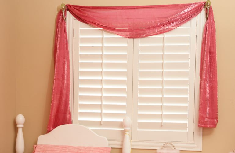 Kid's room with plantation shutters.