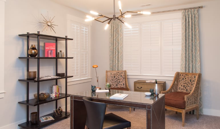 New York City home office with plantation shutters.