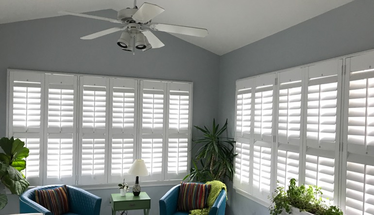 Hartford sunroom with fan and shutters