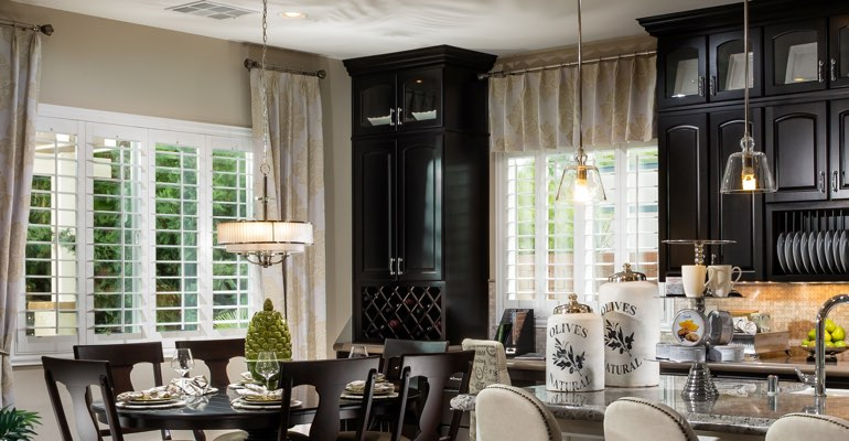 New York City kitchen dining room with plantation shutters.
