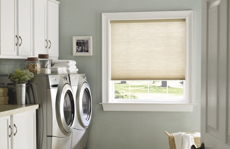 New York City laundry room with pull-down window shades.