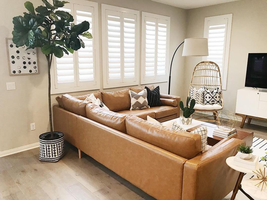 Warm living room with our Polywood shutters in New York City.