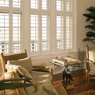 New York City living room polywood shutters.
