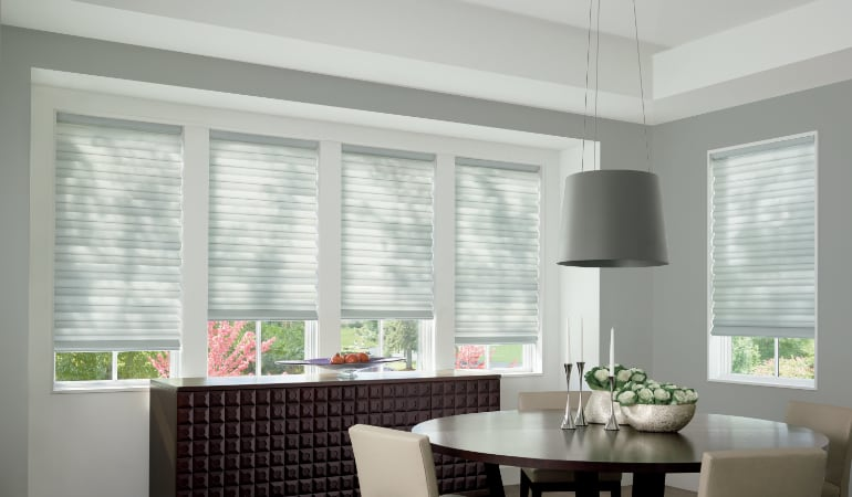 Cellular shades in a New York City dining room.