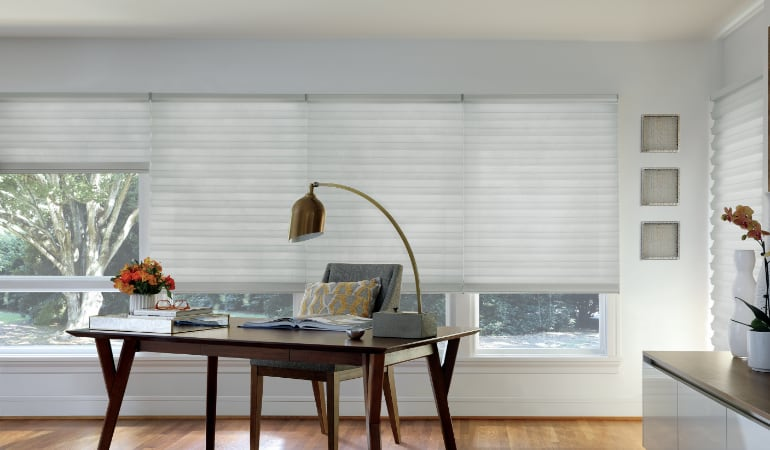 Motorized shades in a home office.