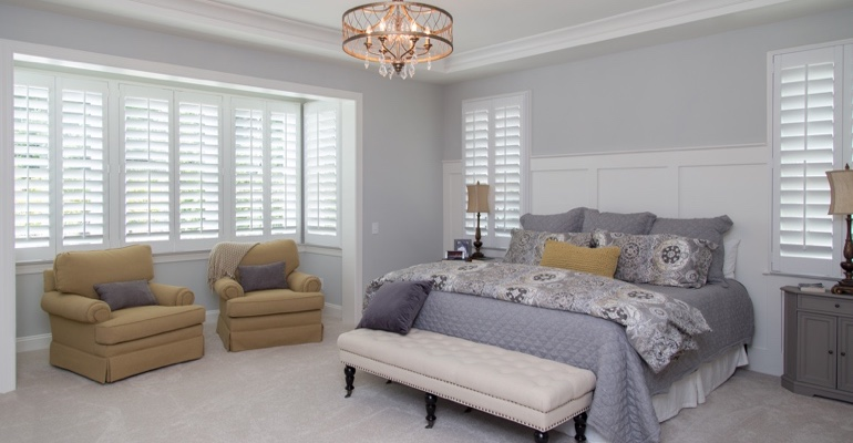 Interior shutters in New York City bedroom.