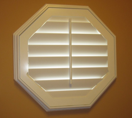 New York City octagon window with white shutter