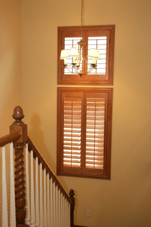 Ovation shutters in tan staircase.