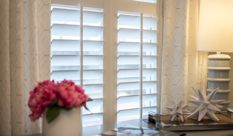 Plantation shutters by flowers in New York City