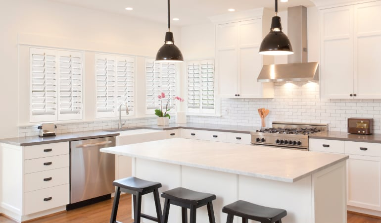 Plantation shutters in a bright New York City kitchen.