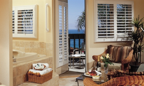 Plantation Shutters On Casement Windows In A Lakefront House