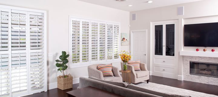 Hartford living room in white with plantation shutters.