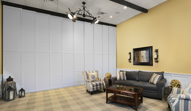 Interior shutters as a room divider for a business