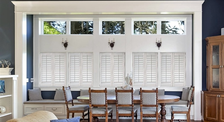Closed white plantation shutters in Hartford dining room.