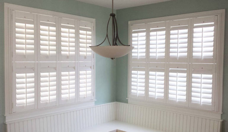 Soft green wall in Hartford kitchen with shutters.