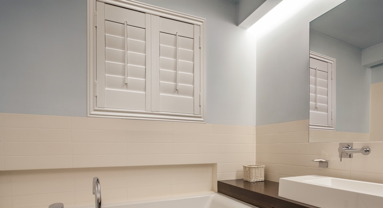 Plantation waterproof shutters in New York City bathroom.