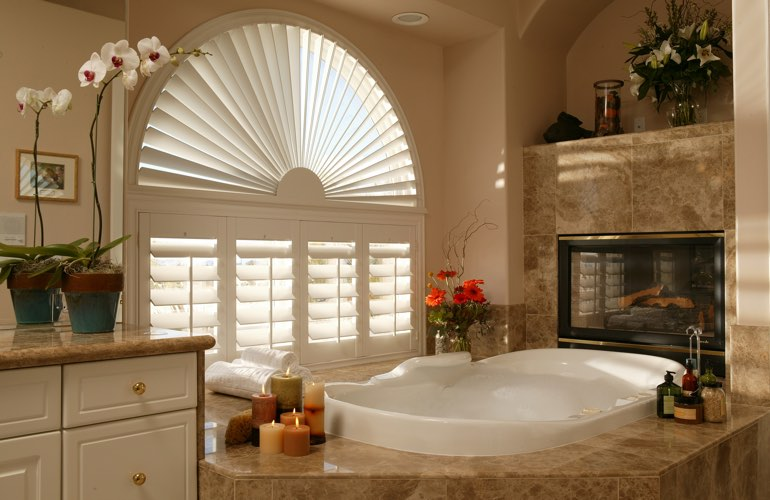 Semicircle shutters in a New York City bathroom.
