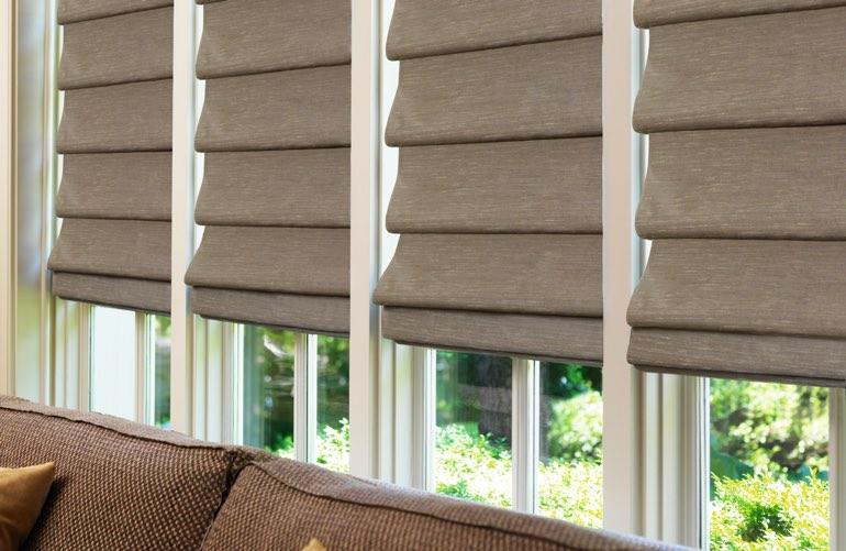 Decorative Roman Shades In Brown Sunroom Window