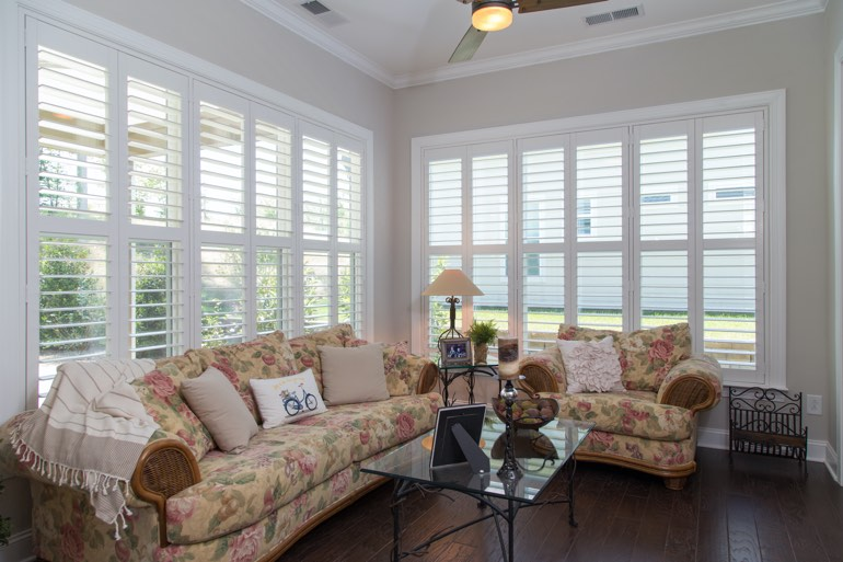Traditional sunroom with interior shutters in New York City.