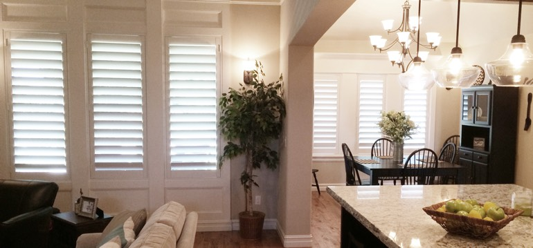 New York City shutters in dining room and family room