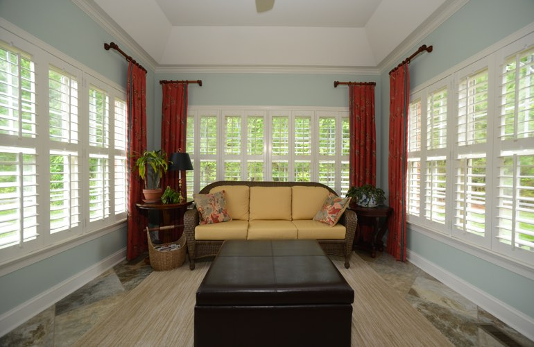 New York City sunroom with plantation window shutters.
