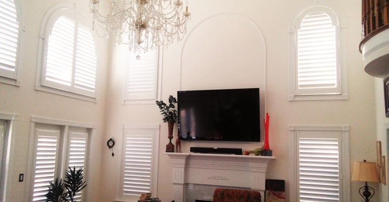 high ceiling windows with shutters New York City great room