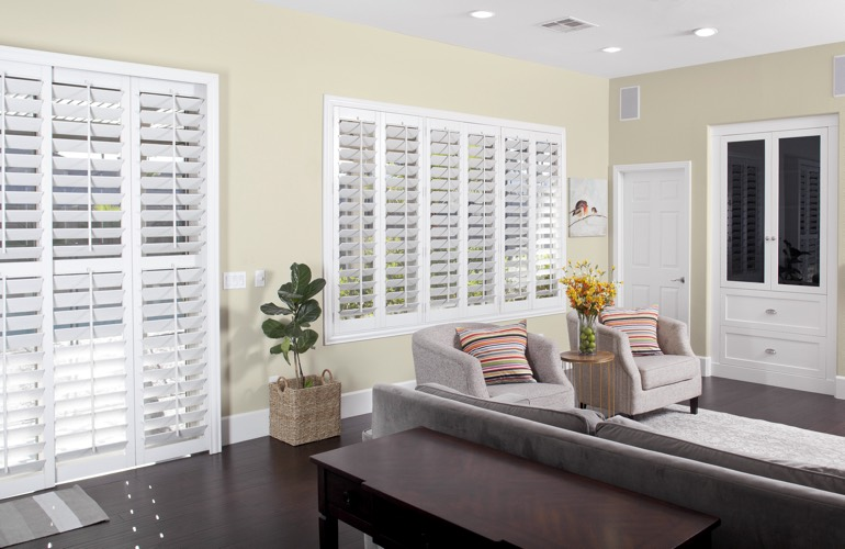 White plantation living room shutters