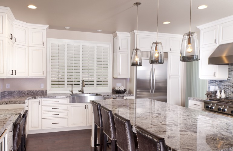 Plantation shutters covering a kitchen window