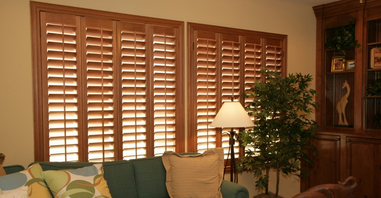 Natural wood shutters in New York City living room.