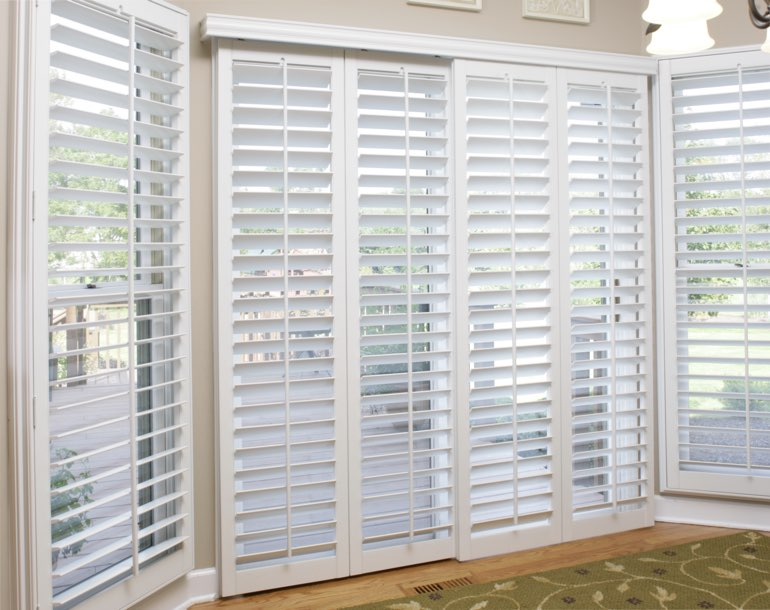 Sliding glass door with white shutters New York City